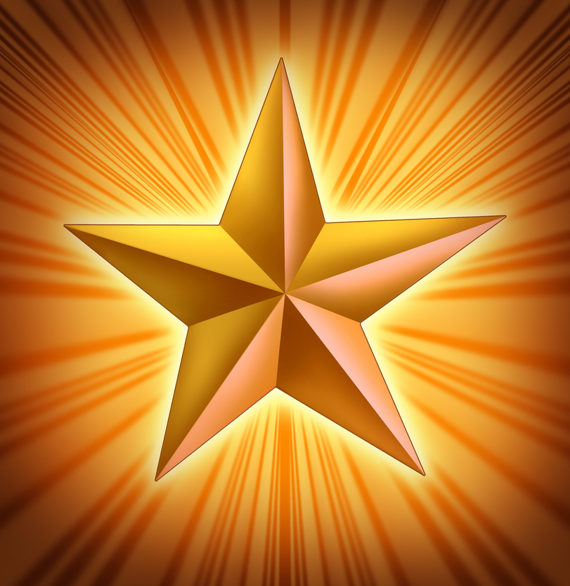 Gold star with starburst light blast representing the symbol of success and fame.